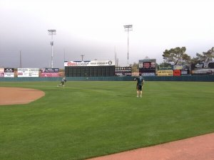 Derek Norris and Brandon Moss wonder why no one else wants to play catch with them on a cloudy day in Phoenix