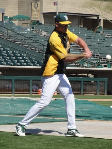 Manager Bob Melvin hitting grounders to Scott Sizemore at second base